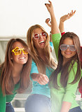 Smiling teenagers with funny glasses