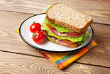 Sandwich with salad, ham, cheese and tomatoes