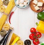 Italian food cooking ingredients. Pasta, tomatoes, peppes