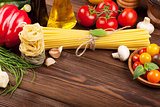 Italian food cooking ingredients. Pasta, tomatoes, basil