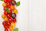 Colorful cherry tomatoes and basil
