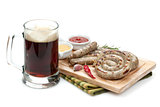 Grilled sausages with ketchup, mustard and mug of beer