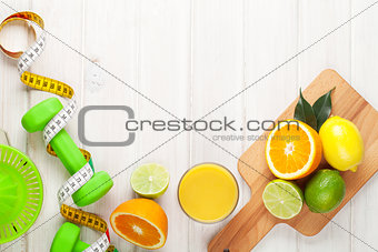 Citrus fruits, tape measure and dumbells