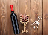 Red wine bottle, glass shaped corks and corkscrew
