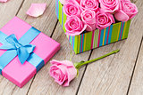 Valentines day card with gift box full of pink roses