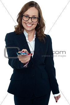 Business executive offering you a credit card