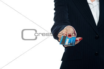 Cropped image of a woman holding credit card