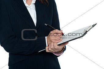 Cropped image of female secretary taking notes