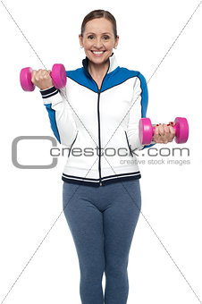Active woman posing with dumbbells