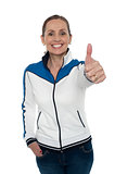 Joyous woman showing thumbs up gesture