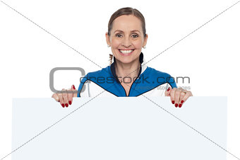 Charming woman holding blank whiteboard