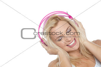 Tilted shot of a blonde engrossed in music