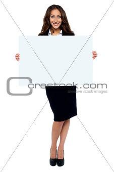 Corporate woman displaying blank whiteboard