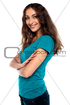 Attractive female standing sideways and smiling