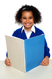 Smiling school girl learning weekly assignment