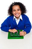 African elementary school kid using a calculator