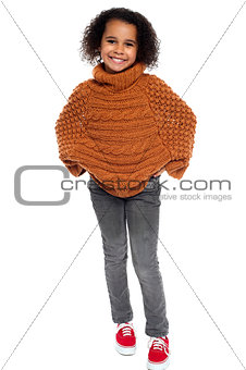 Portrait of lovely kid girl wearing winter clothing