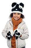 Portrait of a lovely little girl in winter outfit