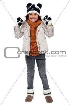 Charming young girl enjoying winters