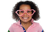 Pretty girl with a wide grin. Wearing funny frame