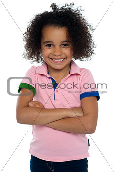 African girl with a cute smile posing casually