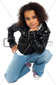 Afro American kid posing stylishly to the camera