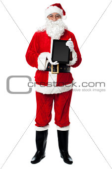 Saint Nicholas displaying a brand new tablet device