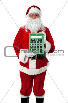 Old man dressed as Santa showing a large green calculator