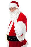 Happy Santa showing thumbs up to camera