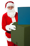Photo of kind Santa Claus giving xmas presents