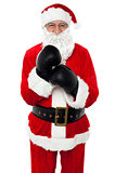 Aged cheerful Santa wearing boxing gloves