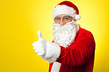 Santa showing thumbs up gesture to camera