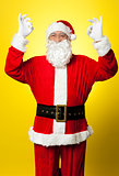 Aged Santa gesturing perfect sign with both hands