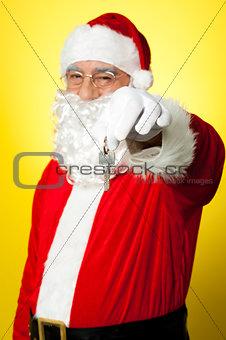 Aged Santa dangling a key