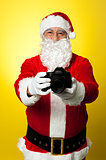 Santa Claus holding up his brand new DSLR