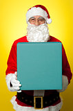 Isolated smiling Santa holding gift box
