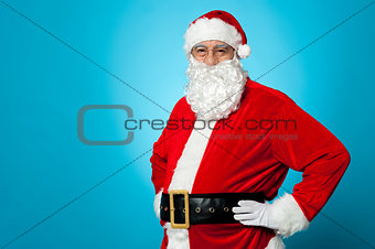 Aged Santa posing with hands on his waist