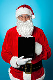 Father Christmas presenting a new tablet device