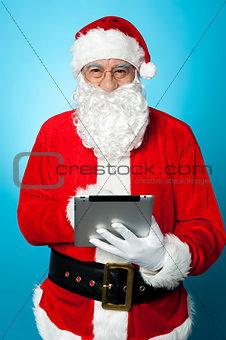 Modern Santa using digital touch screen device
