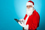Santa using newly launched electronic tablet device