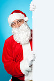 Santa posing beside long blank banner ad