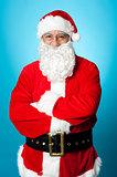 Confident aged male in Santa costume