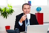 Boss enjoying hot coffee during work break