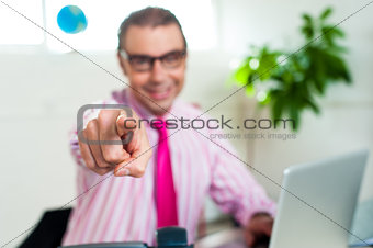 Smiling business professional pointing you out