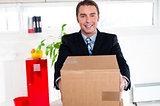 Active executive carrying packed carton