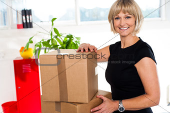 Blonde woman is ready to unpack her office stuff