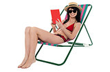 Young woman reading book and relaxing