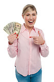 Pretty woman holding up dollar notes