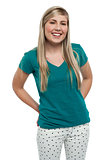 Long haired blonde teen girl in casuals