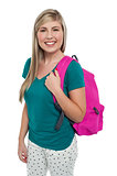 Teen posing with pink backpack
